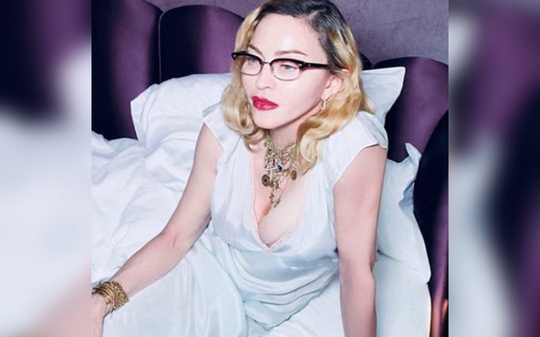 Madonna Poses Topless Only Wearing a Hat at 61
